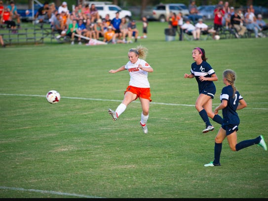 Powell's Raygan Scarbrough, left, on the attack for