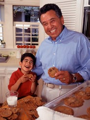 grandfather and boy baking cookies