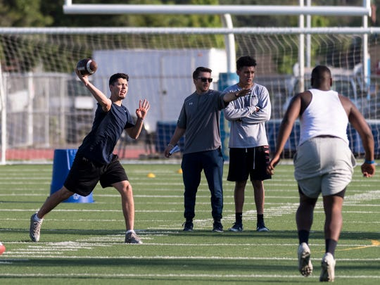 Gus Villareal, from Dinuba, passes during COS' spring