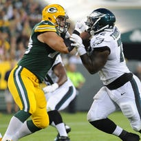 Green Bay Packers offensive guard JC Tretter (73) blocks Cedric Thornton (72) against the Philadelphia Eagles at Lambeau Field August 29, 2015.