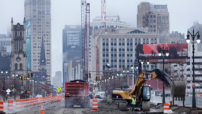 Looking south on Woodward Avenue to downtown Detroit as construction continues for the M1-line, Tuesday, March 31, 2015.