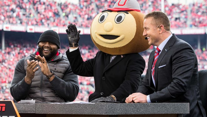 Former Ohio State lineman Orlando Pace with ESPN College Gameday commentators Lee Corso (wearing Brutus Buckeye head) and Kirk Herbstreit  before last year's win over Michigan.