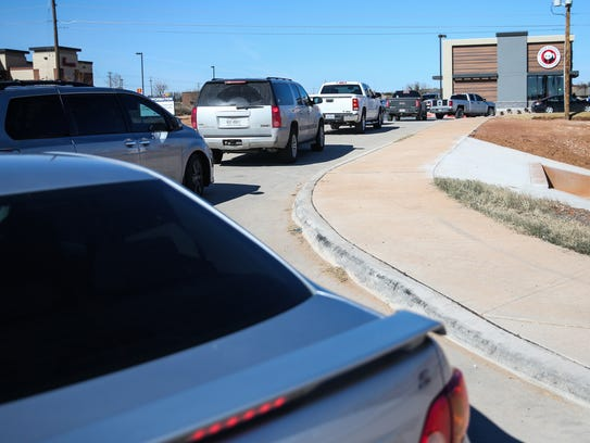 A line of cars reaches the street during lunch time