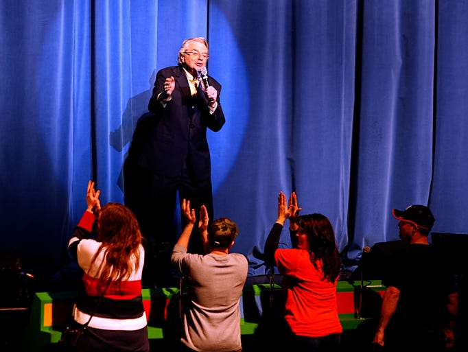 Host Jerry Springer greets the first four lucky contestants