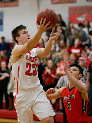 Lutheran's Brock Staudt (23) takes it to the hoop for two against Oostburg at Manitowoc Lutheran High School Friday, Feb. 9, 2018, in Manitowoc, Wis.