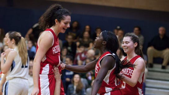 North Rockland players smile and help Olivia Levy (5)