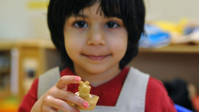 """Seerat Parhar, 4, and other students at Almond Road Preschool in Vineland prepare """"Just Right Oats"""" for their parents."""