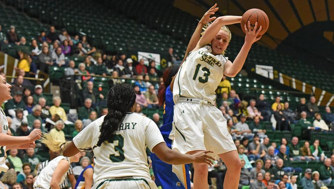 CSU's Ellen Nystrom grabs a rebound during the Rams' 76-54 win over San Jose State at Moby Arena on Saturday.