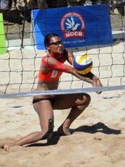 In this file photo, Guam women's national beach volleyball player Tatiana Sablan receives a serve during a match against Vanuatu at the Pacific Games in Port Moresby, Papua New Guinea in 2015.