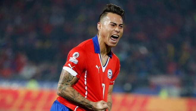Chile's Eduardo Vargas, right, celebrates after scoring against Peru during a Copa America semifinal soccer match