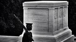 A guard marches in front of the Tomb of the Unknown Soldier at Arlington National Cemetery.