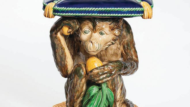 """This majolica monkey crouching under a pillow must be a seat inside the home of the lucky bidder who bought it for $13,530 at a recent Boston auction. The seat is 18 inches high, the comfortable height for a chair. It is marked """"Mintons,"""" proving it is old."""