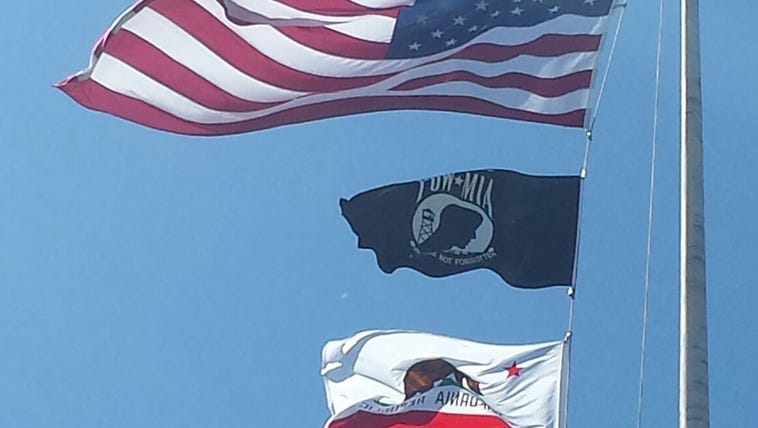American, Legion and California flags replace the three