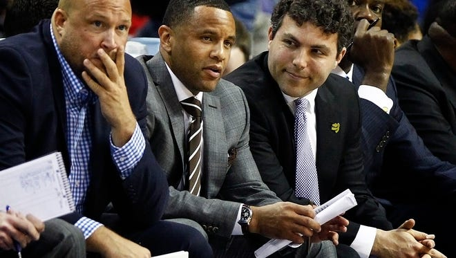 December 18, 2015 -  Memphis head coach Josh Pastner (right) along with assistant coaches Damon Stoudamire (middle) and Julian Swartz (left) look on as the Tigers fell behind the Ole Miss during first half action at the FedExForum. (Mark Weber/The Commercial Appeal)