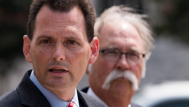Alabama Attorney General candidate Troy King stands with attorney Al Agricola as he responds to his suit being dismissed in Montgomery, Ala, on Thursday July 12, 2018.