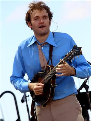 """In this file photo, Chris Thile and Punch Brothers performs on day 3 of the Lockn' Festival at Oak Ridge Farm in Arrington, Va. Thile, says hosting """"A Prairie Home Companion"""" is like """"getting to be Luke Skywalker."""" Thile will substitute for """"Prairie Home"""" host and creator Garrison Keillor on the public radio show today and Feb. 14 from the Fitzgerald Theater in St. Paul."""
