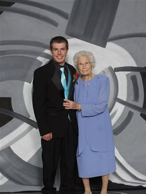 This photo provided by Inter-State Studio & Publishing Co. Shows Drew Holm and his great-grandmother Kathryn Keith in their prom picture. The Indiana teenager who took  93-year-old Keith to his junior prom says he had a great time, even though her early bedtime nearly cut the night short. Holm then took his girlfriend to an after-prom event at a bowling alley.