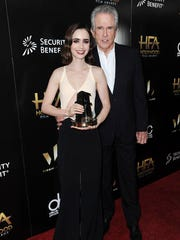Lily Collins, left, and Warren Beatty attend the press