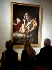 "Visitors admire the ""Judith Slaying Holofernes"" painting by Italian 17th century artist Artemisia Gentileschi, on display at Rome's Braschi Palace museum, Tuesday, Nov. 29, 2016. The Braschi museum is hosting the 'Artemisia Gentileschi and her Times' exhibition from Nov. 30, 2016 to May 7, 2017."