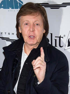 """FILE- This Dec. 19, 2016 file photo shows Paul McCartney as he arrives for a screening of """"This Beautiful Fantastic"""" at the SVA Theatre in New York. McCartney filed a lawsuit in federal court in New York on Wednesday, Jan. 18, 2017 against Sony/ATV over copyright ownership of the many hit songs he wrote with John Lennon as part of The Beatles. He's trying to recover ownership of the music that was purchased by Michael Jackson in 1985 and then fully sold over to Sony/ATV following his death. (Photo by Charles Sykes/Invision/AP, File)"""