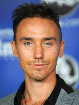 FILE - This Jan. 23, 2013 file photo shows Canadian filmmaker Rob Stewart at the Modern Master Award Ceremony at the Santa Barbara International Film Festival in Santa Barbara, Calif. The family of Stewart, who died during a shark filming excursion in the Florida Keys has filed a wrongful death lawsuit. The lawsuit blames negligence on the companies and individuals who organized the January dive that resulted in Stewart's death.