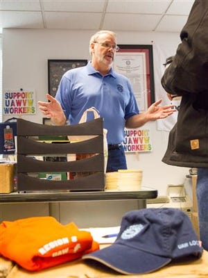 In this Nov. 18 photo, United Auto Workers Local 42 President Mike Cantrell speaks to fellow Volkswagen employees at the union's office in Chattanooga.