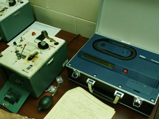 Pictured here a closeup of the old (50 yrs. or more??) Breathalyzer on the left and the Alcotest on the right.