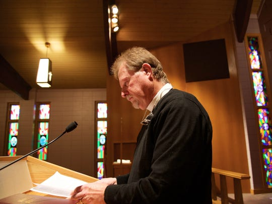 Pastor William Kilps stands at the podium near the