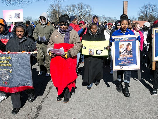 Marchers participating in the MLK ceremonies Monday
