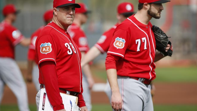 Cincinnati Reds manager Bryan Price, left, shown during spring training in Goodyear, Arizona, is not to blame for the team's performance.