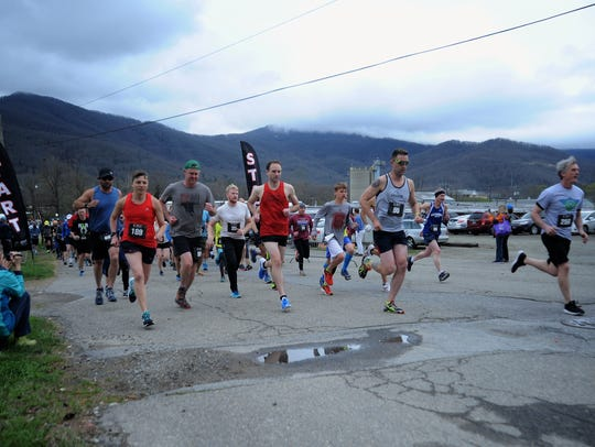 Runners take off from Pisgah Brewing Co. to begin the Black Mountain Greenway Challenge in 2018. The event, which raises money for the town's Greenways Commission, returns for its 12th year on April 6.