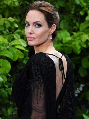 Angelina Jolie attends a private reception as costumes and props from Disney's 'Maleficent' are exhibited in support of Great Ormond Street Hospital at Kensington Palace on May 8, 2014 in London.