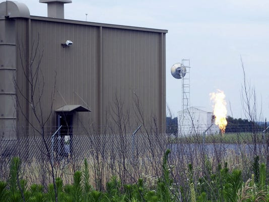 Flames from a candlestick flare burn off propane Monday at the Sunoco Logistics pumping station in West Cornwall Township in this photo taken by Doug Lorenzen.