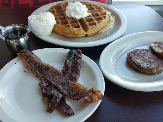 The Belgian Waffles ($7.39) with a side of bacon and sausage at The Game II - Extra Innings.