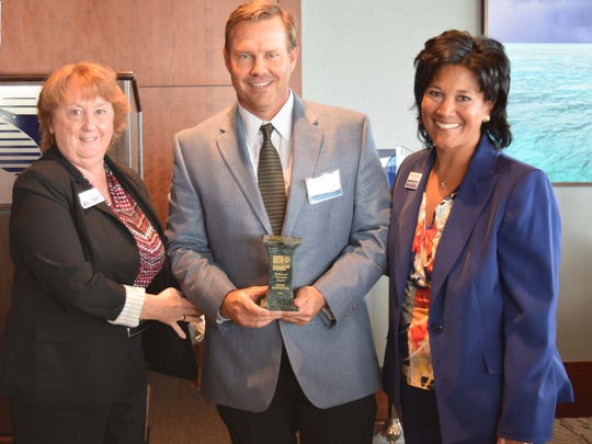 Holly Laiben (left), director of  Character Counts!, and Carol G. Houwaart-Diez (right), president and CEO of United Way of Martin County, present the Business of Character Award to Steve Hooks of, Hooks Construction.