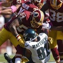Washington Redskins defenders tackle Philadelphia Eagles wide receiver Jordan Matthews in Sunday's game.