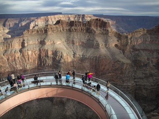Visitors enjoy the view from Skywalk, January 16, 2018, at Grand Canyon West, Arizona.