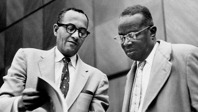 Avon N. Williams Jr., left, goes over files with NAACP attorney Z. Alexander Looby during a segregation hearing at the Federal Courthouse in Nashville.
