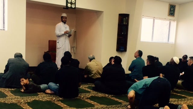 Imam Mohamed Taha leads the Friday service at the Islamic Center of Asheville.