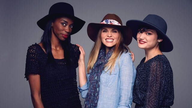 Models pose for a photo in hats and hatbands made by Stephanie Ryan of Fancy Fedora. The local business recently began selling its products at Three French Hens and Peek of Chic in Hyde Park.
