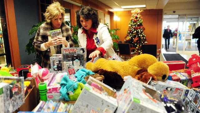 In 2010, Angie Ross of Townsquare Media and 911 Gives Hope, left, and Carlene Oliver, director of St. Mary's Hospital for Women and Children's Pediatric Unit, sort through boxes of gifts donated to the hospital to give out to children.