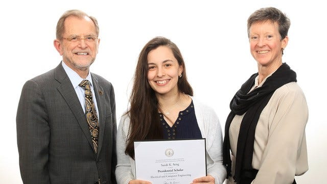 Sarah Seng is a 2011 Battle Creek Central High School graduate. Pictured with her: WMU President John Dunn and WMU Faculty Senate President Suzan Ayers.