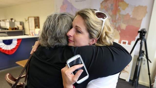 Former Rutherford County Election Commission Administrator Nicole Lester hugs supporter Ruthan Patient after Lester was fired by the election commission during a meeting Monday, July 7, 2014, at the Rutherford County Election Commission.