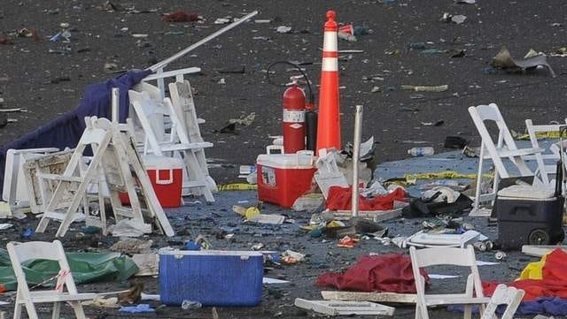 Coolers that held beverages for Reno Air Races fans lay among the debris Sept. 17, 2011, from the air crash that killed nine people, including the pilot, on Sept. 16, 2011.