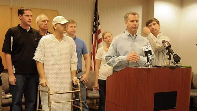 Allen Elvin, a cousin of the Elvin family and spokesman for the family, speaks during a news conference at Renown Medical Center on Sept. 21, 2011. Behind him are other family members including Brian, 49, who walked into the conference on a walker and missing his right leg. The man at the left is not identified. The others, left to right are Barry Elvin, Brian, David Elvin, Jeannifer Deuson and Jim Elvin.
