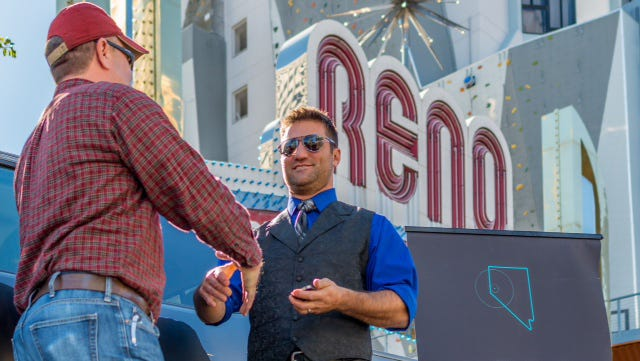 Rider zero, Shawn Plunket, steps into his waiting ride in October as Uber launched its service in downtown Reno. Uber launched a petition Tuesday, Dec. 2, 2014, seeking 30,000 signatures as part of efforts to restart its service in Nevada.