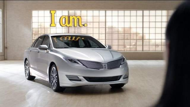 "A scene from the new Lincoln MKZ TV ads in which a couple ""interviews"" the MKZ and a Lexus, highlighting advantages over the rival."