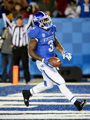 Kentucky running back Jojo Kemp scores a touchdown during the first half of an NCAA college football game against Charlotte, Saturday, Nov. 21, 2015, in Lexington, Ky.
