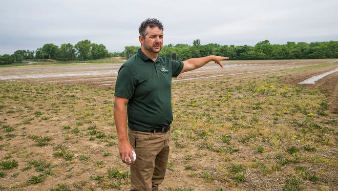 Jonathan Lawler, of Brandywine Creek Farms, talks about the variety of vegetables that he is growing on a 33-acres farm inFishers on Friday, May 18, 2018. Kale, cucumbers, tomatoes, peppers and watermelon were mentioned.