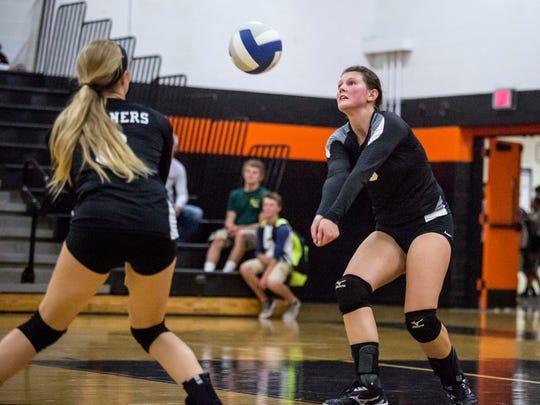Marine City senior Hannah Walendowski digs the ball
